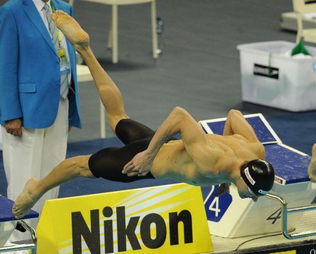 Cesar Cielo salta; nadador brasileiro conquistou sua segunda medalha de ouro no Mundial de Esportes Aquáticos, em Xangai (China), ao vencer a disputa nos 50m livres