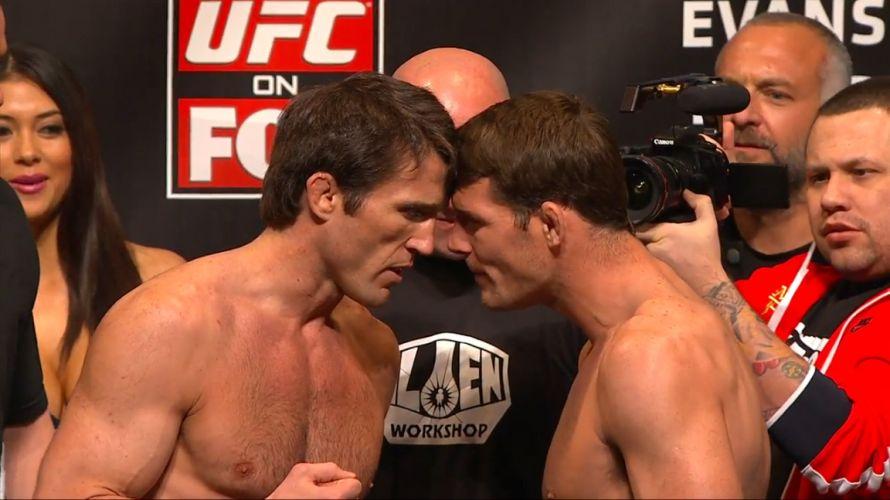 Pesos médios Chael Sonnen e Michael Bisping tocam cabeças e se provocam na pesagem do UFC on FOX 2, que será realizado neste sábado, em Chicago; britânico foi provocado e mostrou o dedo para a torcida