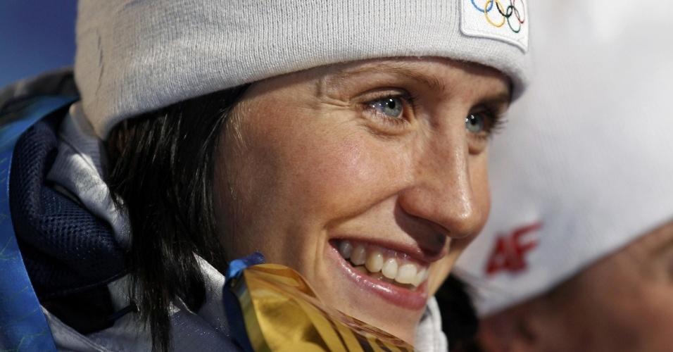Marit Bjoergen, da Noruega, comemora um de seus ouros no cross country