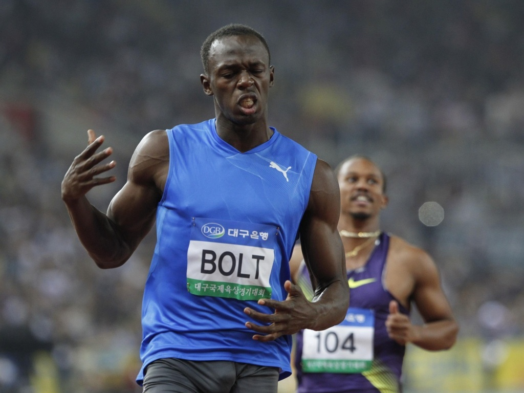 Usain Bolt desaprova o tempo de sua prova nos 100 m rasos de Daegu, na Coreia do Sul