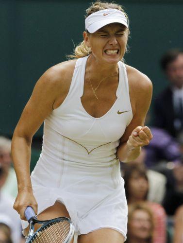 Maria Sharapova reage na derrota por 2 a 0 para a tcheca Petra Kvitova na final de Wimbledon; musa russa não consegue repetir desempenho de 2004, quando foi campeã na grama inglesa