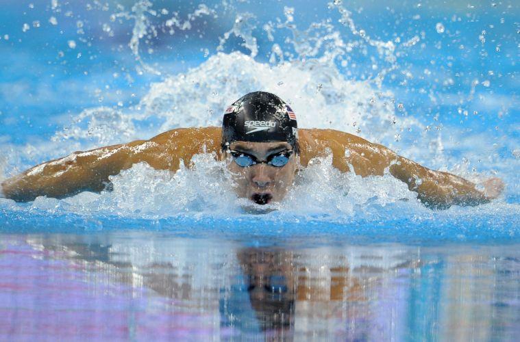 Michael Phelps conquistou a medalha de ouro nos 100m borboleta no Mundial de Esportes Aquáticos em Xangai. Norte-americano fez o tempo de 50s71