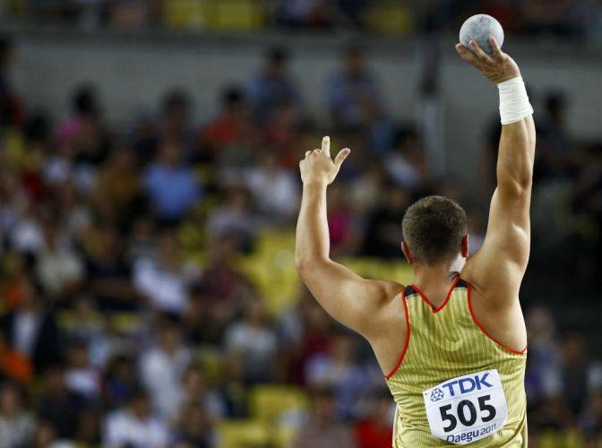O alemão David Storl durante uma de suas tentativas na prova do lançamento de peso. Ele sagrou-se campeão mundial com 21m78.