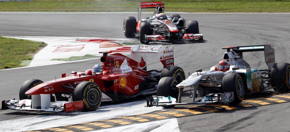 Fernando Alonso, da Ferrari, travou boa disputa com Michael Schumacher, da Mercedes. Espanhol foi o terceiro colocado no GP da Itália e assumiu a vice-liderança do Mundial de pilotos
