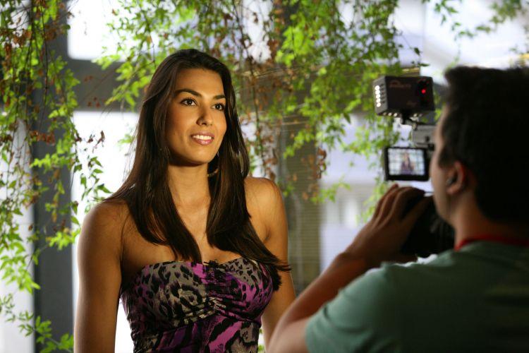 Luciane Escouto durante a entrevista para o UOL Esporte. A morena é jogadora de vôlei e ganhou um concurso de miss no Rio Grande do Sul.