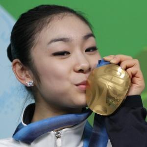 Coreana Kim Yu-Na fica com a medalha de ouro da patinação artística nos Jogos de Inverno de 2010