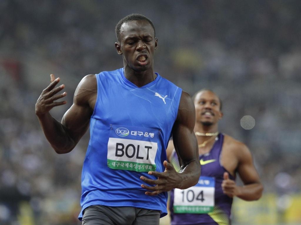 Usain Bolt desaprova o tempo de sua prova nos 100 m rasos de Daegu, na Coreia do Sul