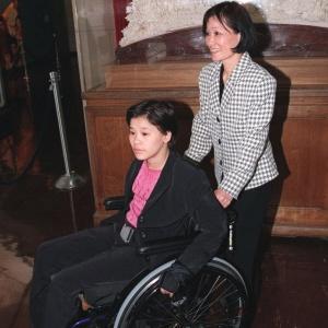 Ginasta chinesa Sang Lan ficou paralítica após se acidentar nos Goodwill Games de 1998